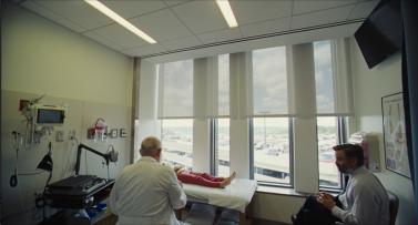 A doctor examines Bob (Sunny Suljic) while Steven (Colin Farrell) looks on