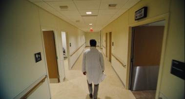 Steven (Colin Farrell) walks through a hospital's corridors